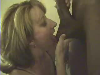 Mature's throat full of chocolate sausage